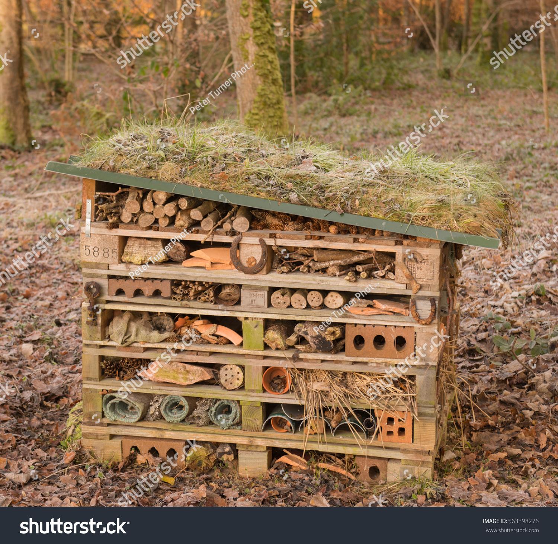 bug hotel invertebrate nesting box on stock photo 563398276