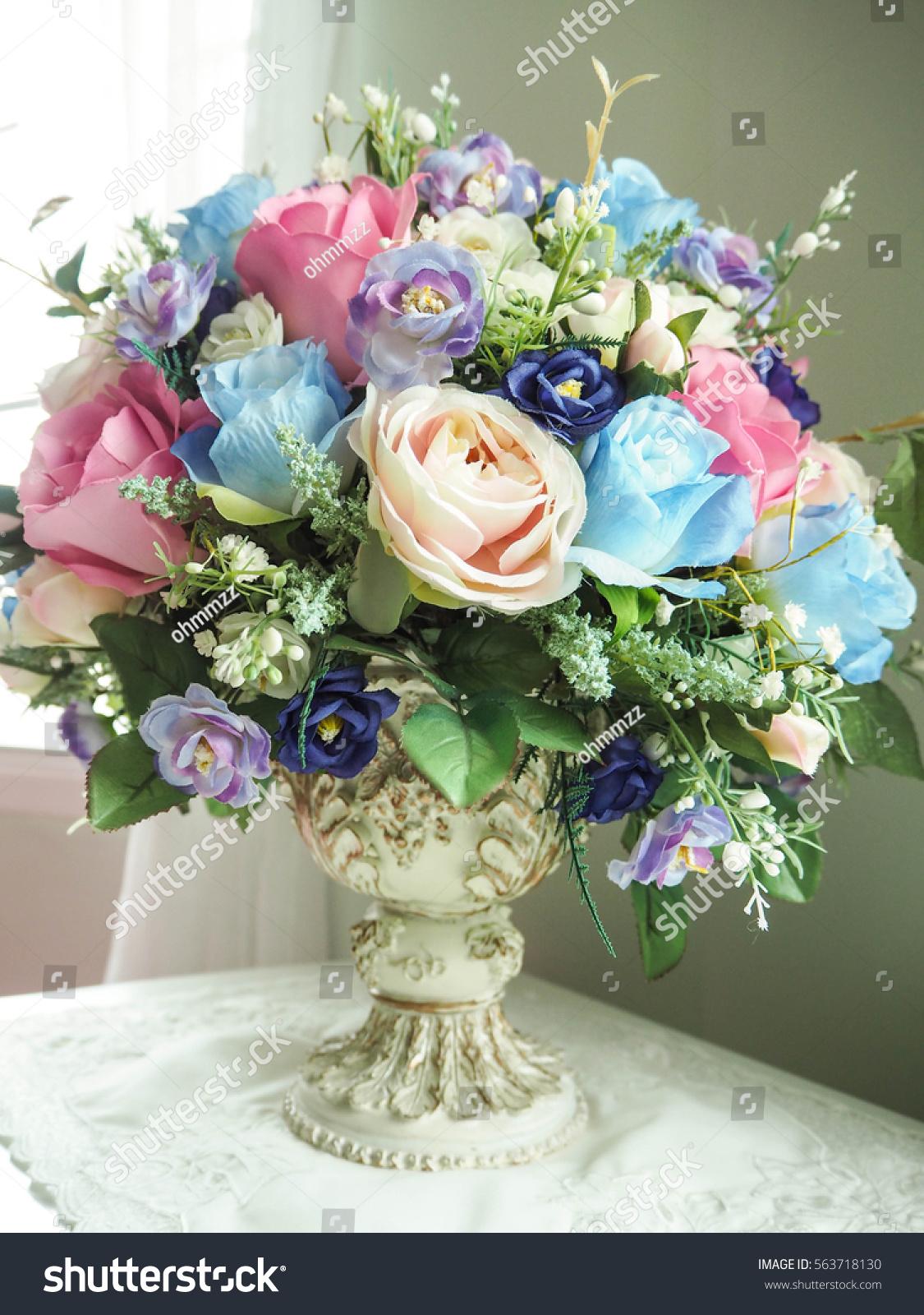 Fake flowers vase on table stock photo 563718130 shutterstock fake flowers in a vase on the table reviewsmspy