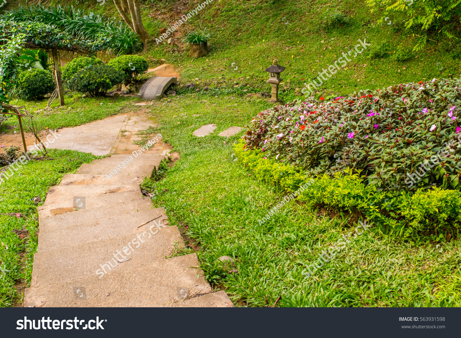 Asian tranquil garden stone path pond stock photo for Tranquil garden designs