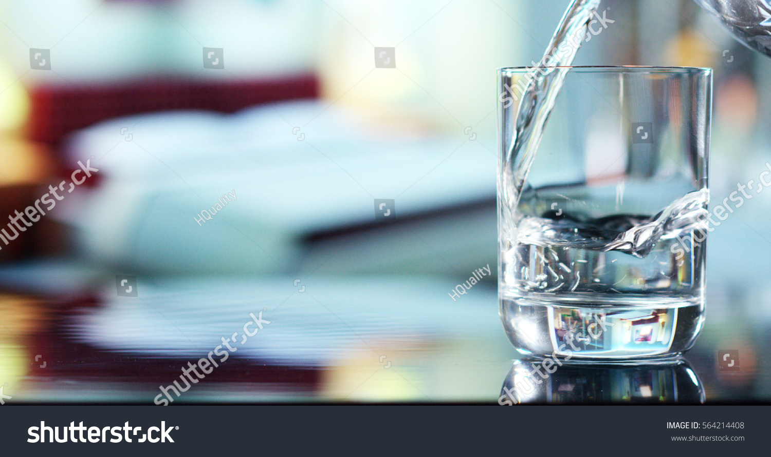 A glass of pure fresh water is poured into a glass, the background bedroom, nature, from which the fresh and pure water. Concept: nature, purification, freshness. #564214408