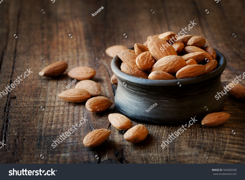 stock-photo-almonds-in-a-black-bowl-agai