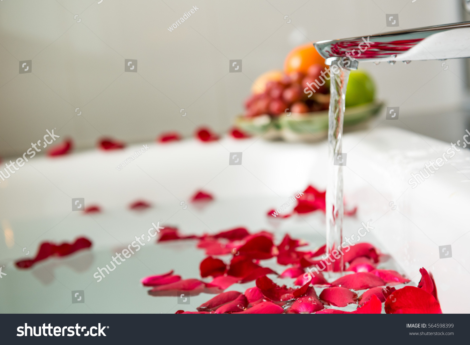 Rose Petals Put In Bathtub For Romantic Bathroom Honeymoon SuitArranged By Interior Designer