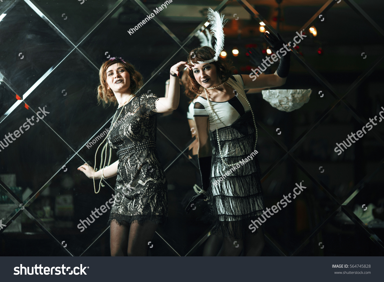 20s style concept two pretty ladies stock photo 564745828