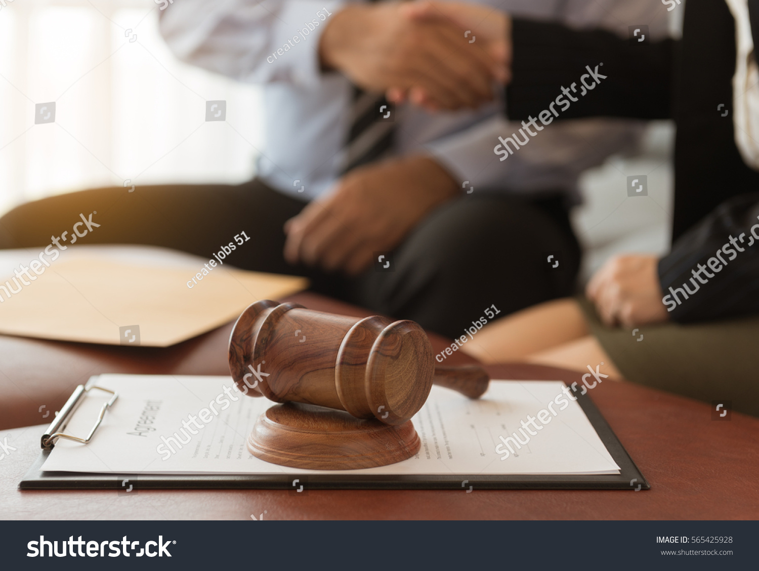 Judge gavel lawyers having team meeting stock photo for Auction advice