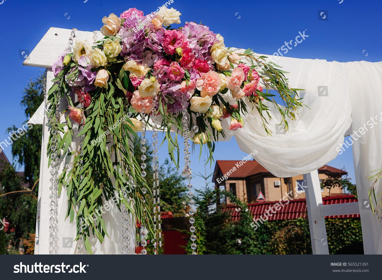 Beautiful fresh flowers on wedding arch stock photo royalty free beautiful fresh flowers on wedding arch stock photo royalty free 565521391 shutterstock izmirmasajfo