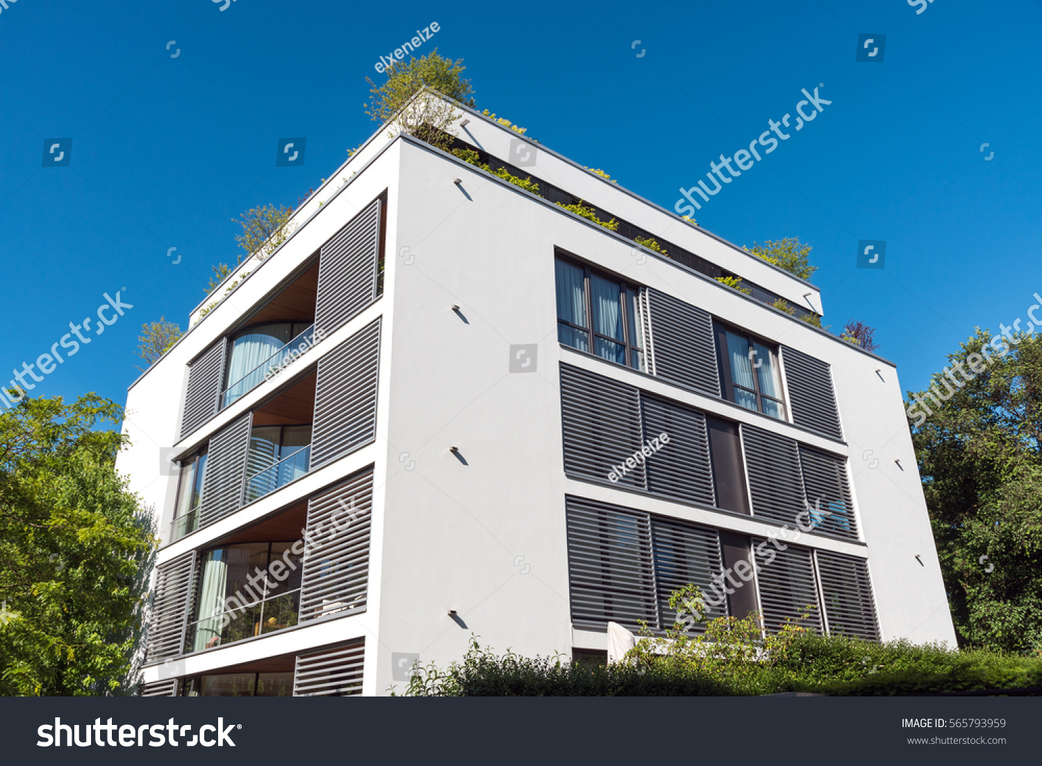 modern white apartment house seen berlin stock photo 565793959 shutterstock. Black Bedroom Furniture Sets. Home Design Ideas