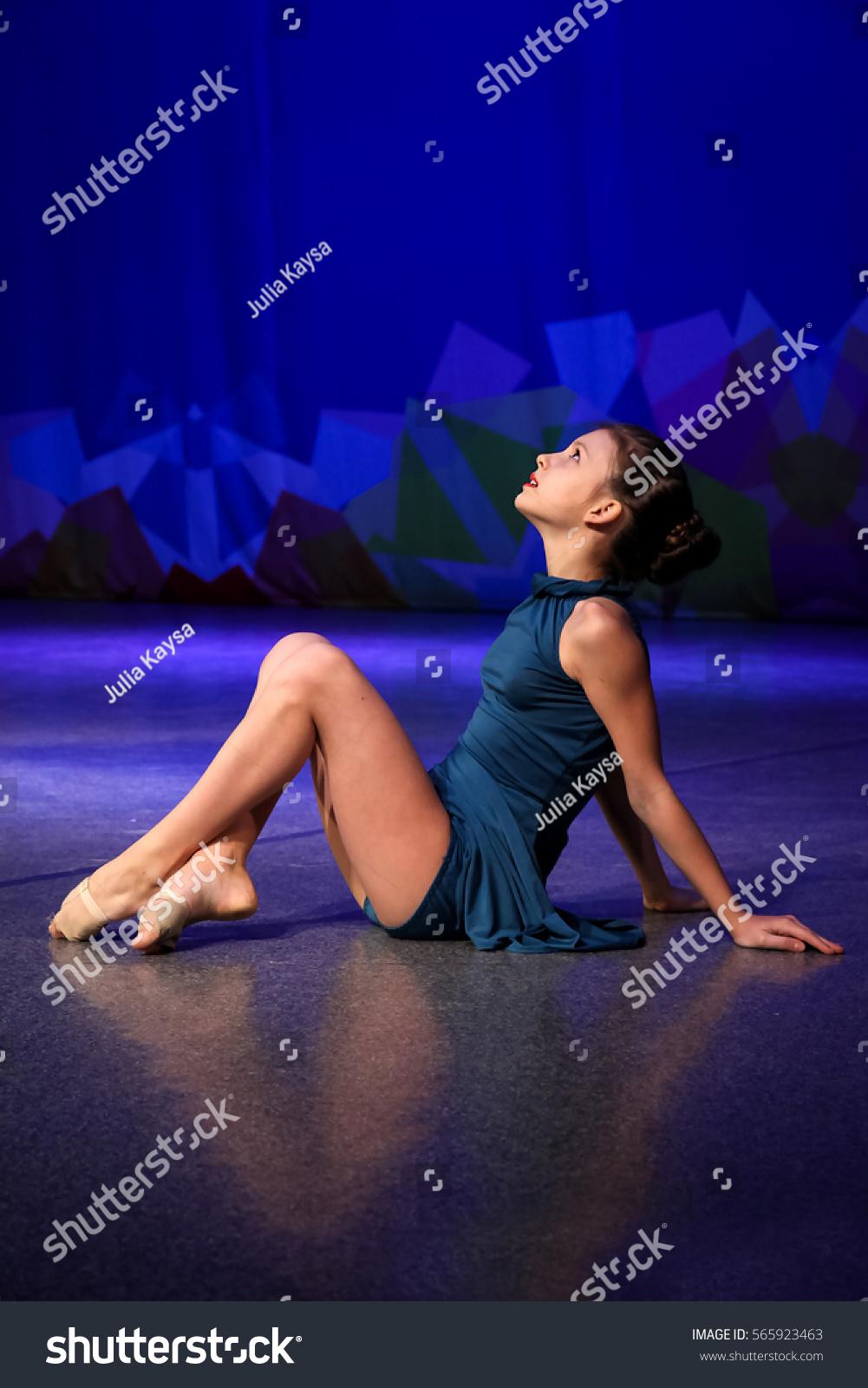 Girl dancing modern dance dancer dreamily stock photo for Dance where you sit on the floor