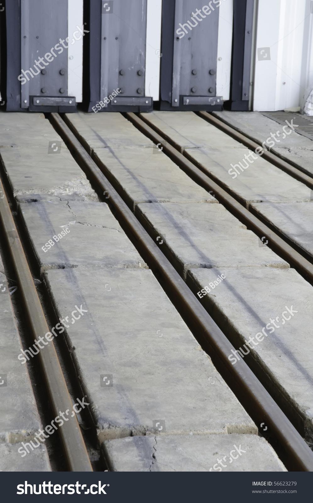 Rails In Concrete Floor For Hangar Door At Airport Stock