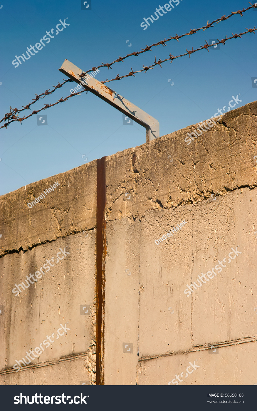 Barbed wire over old concrete wall stock photo