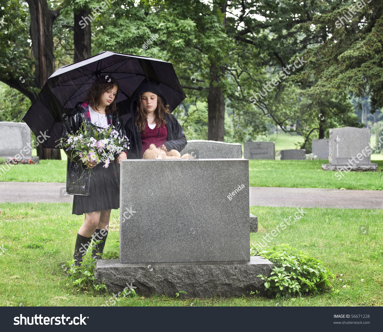 Two Young Girls Visiting Grave Site Stock Photo 56671228