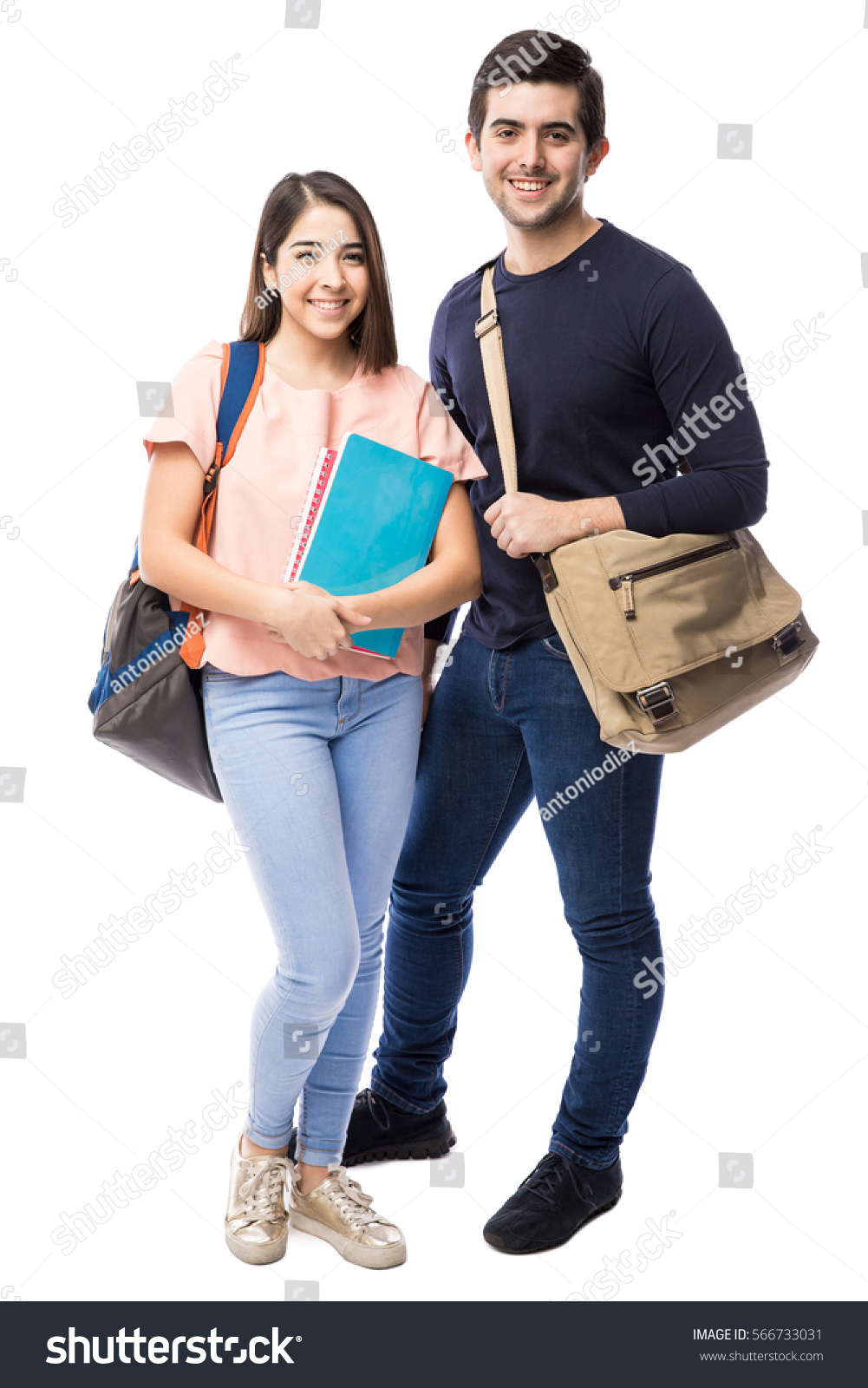 Attractive Young Couple Of College Students With Books And School Bags In A White Background