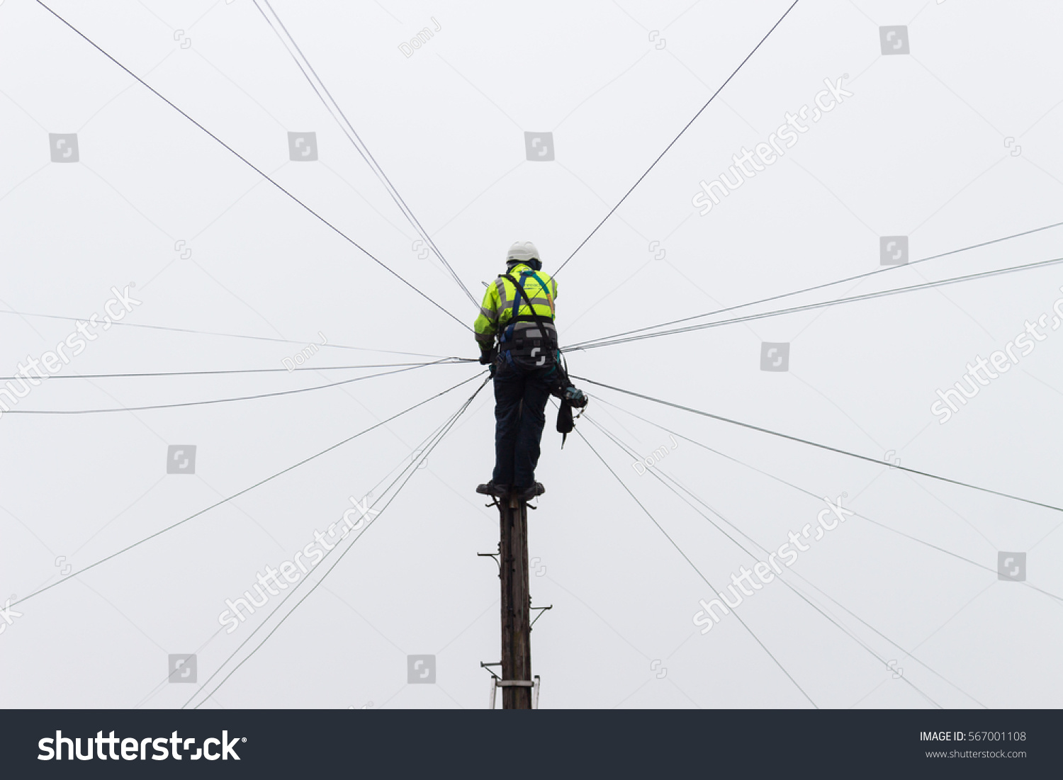 Worker Man Fixing Telephone Wires Electrical Stock Photo Edit Now Together With Wiring And Cable On Home At The Top Of An Electricity