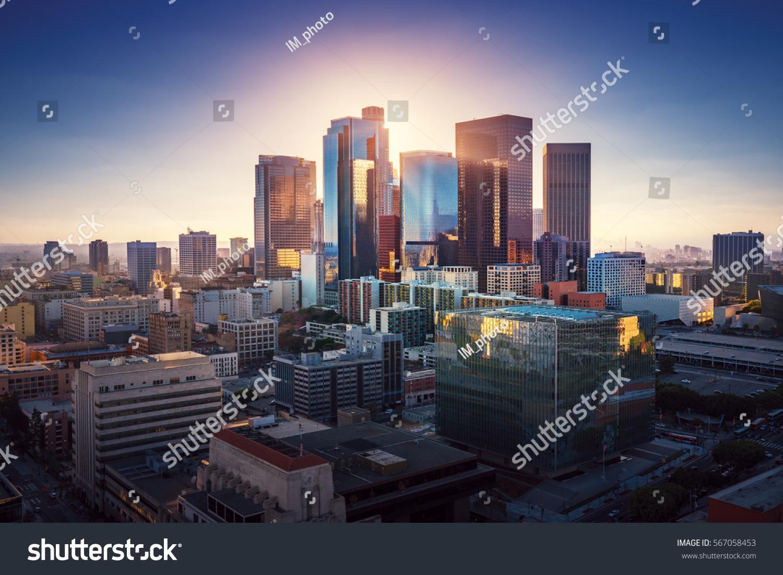 Sunset over Los Angeles downtown. Retro colors. California theme. LA background. Los Angeles city center. #567058453
