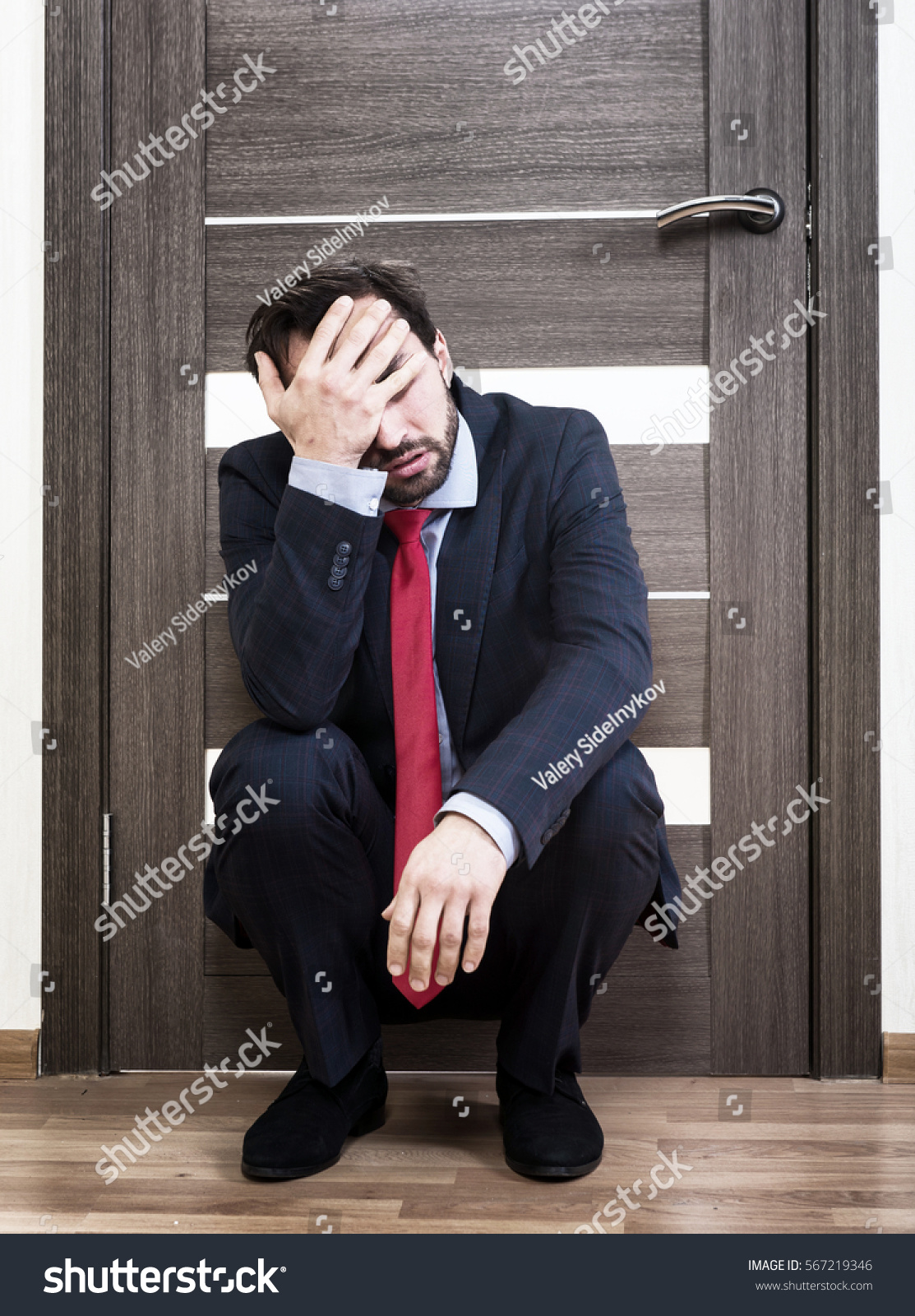 Portrait of an insecure man sitting near the office door & Portrait Insecure Man Sitting Near Office Stock Photo 567219346 ... Pezcame.Com