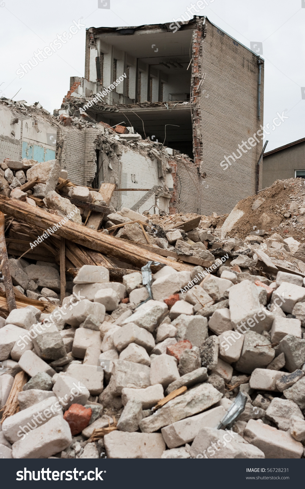 Pile Of Building Debris : Destroyed building and pile of debris stock photo