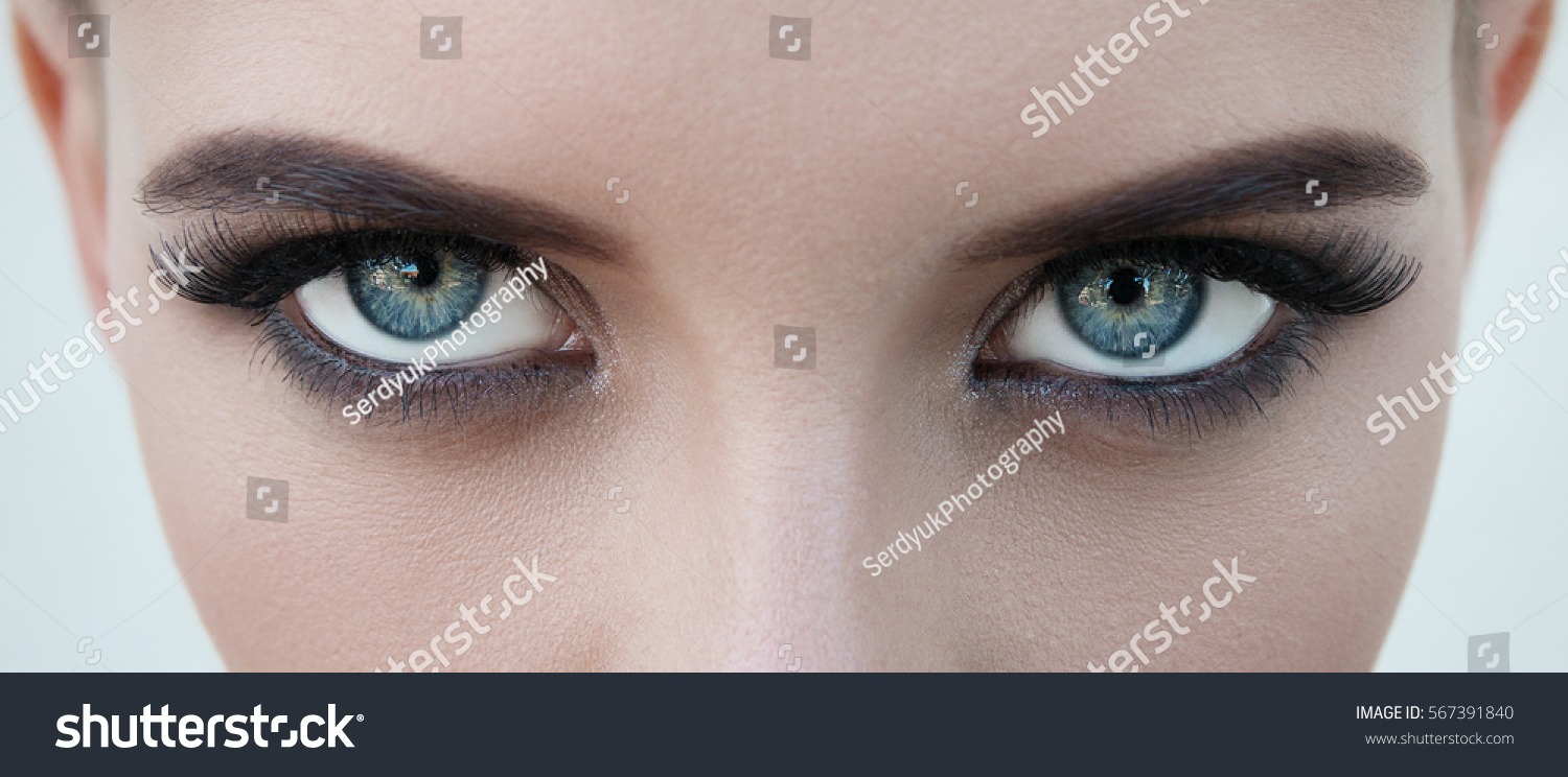 close-up face of pretty girl with beautiful big blue eyes, big eyelashes and eyebrows #567391840 - 123PhotoFree.com