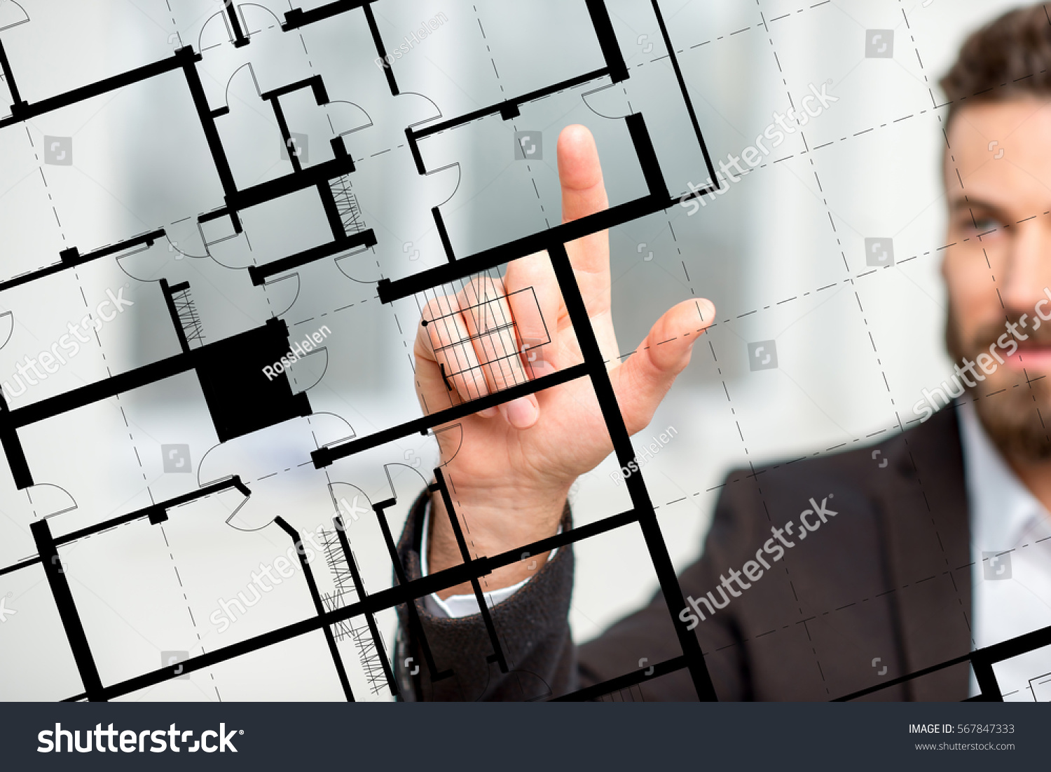 Architect designer working plan drawing on stock photo for Virtual blueprint maker