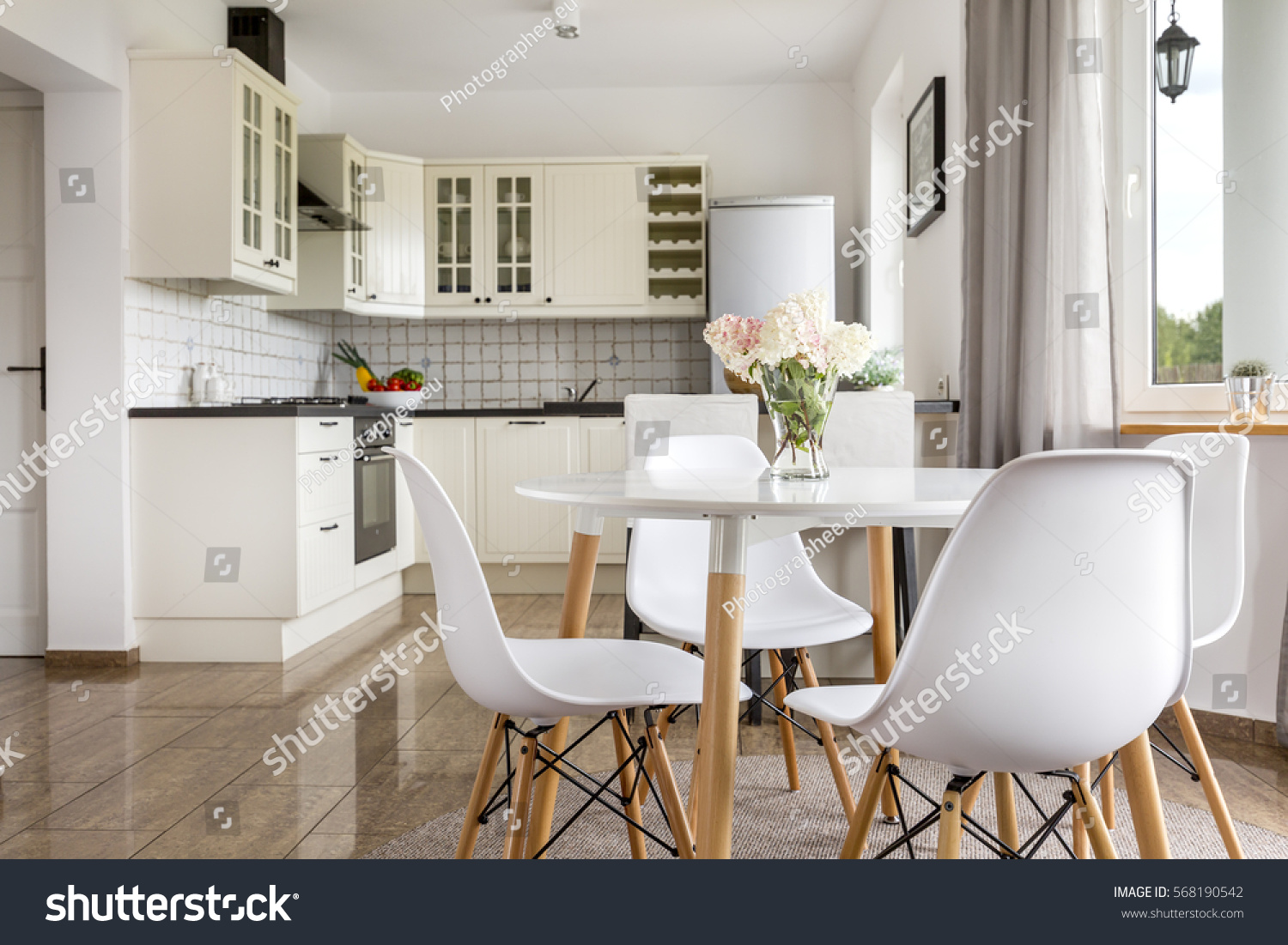 Area of dining room with table and view of the bright open plan kitchen. Area Dining Room Table View Bright Stock Photo 568190542