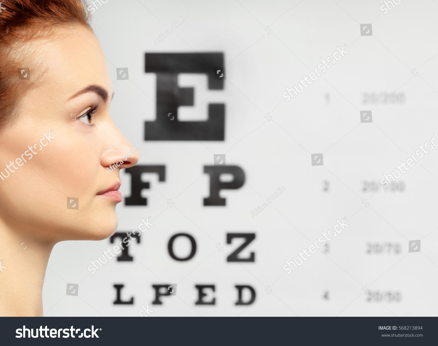 Young Woman On Eyesight Test Chart Stock Photo Edit Now 568213894