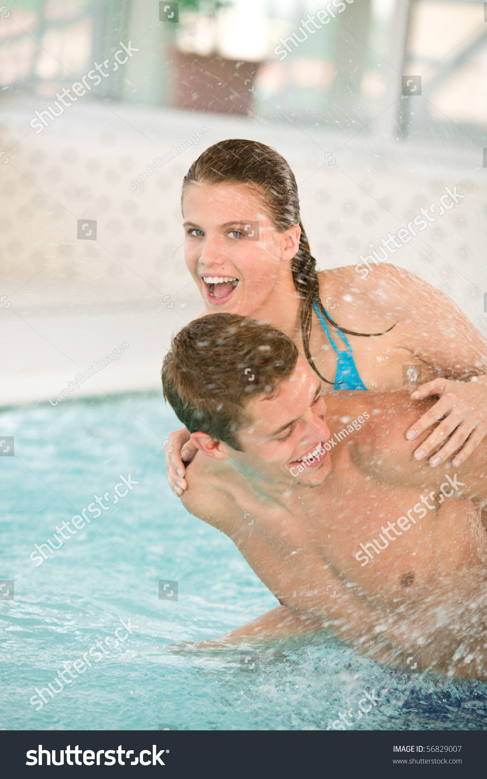 Swimming Pool Young Cheerful Couple Have Fun Under Water Stream Stock Photo 56829007