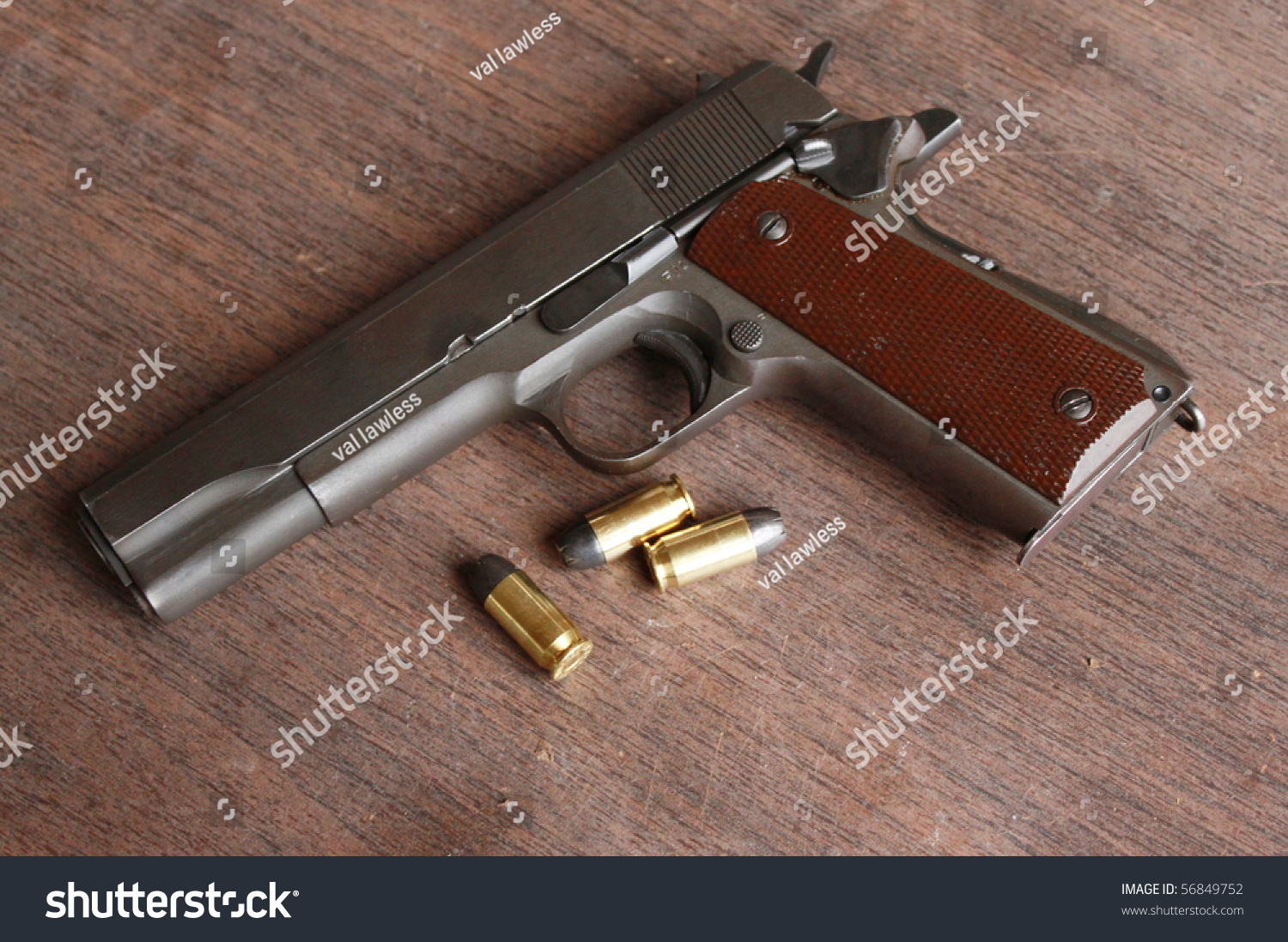 Gun And Bullets On A Table Stock Photo 56849752 : Shutterstock