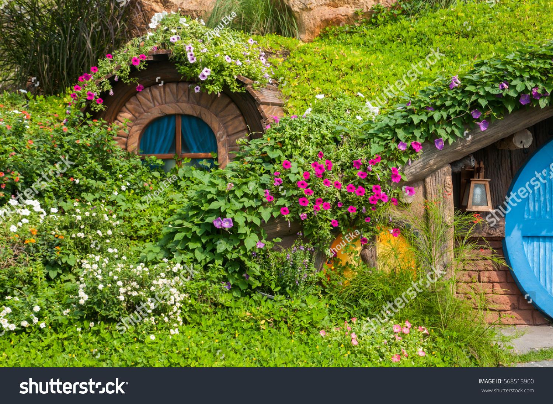 Beautiful garden flowers nice hut stock photo edit now 568513900 beautiful garden with flowers and nice hut izmirmasajfo