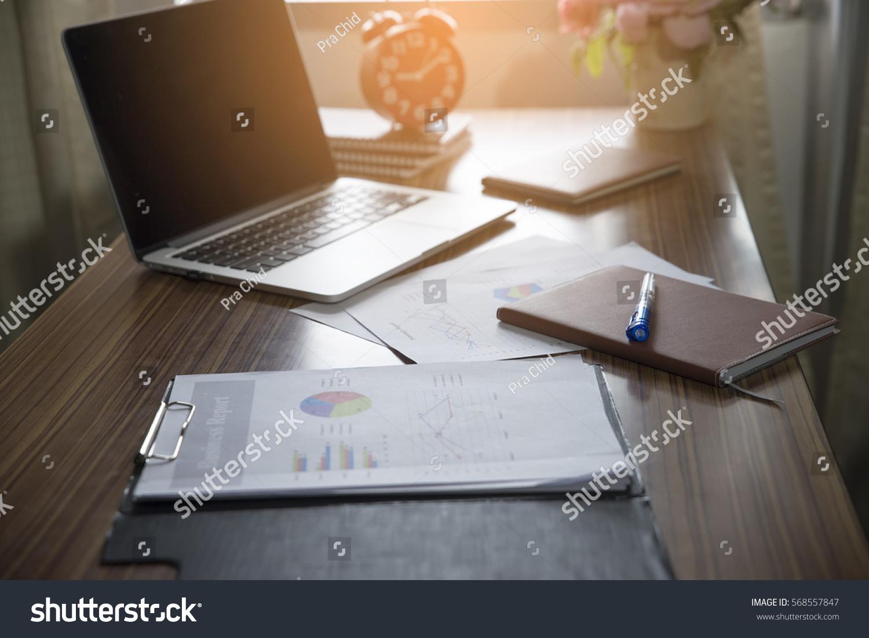 office desk top. Business Computer Office Desk With Desktop Laptop,notebook,clock,pen And Annual, Top U