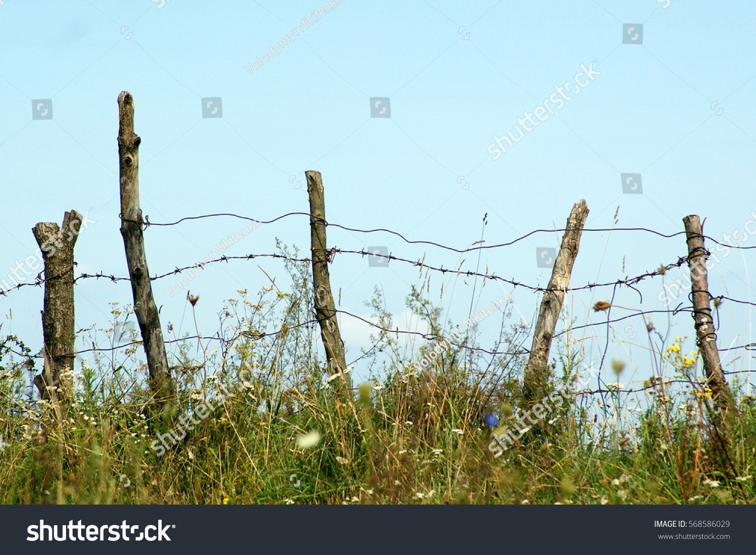 Old Dilapidated Fence Barbed Wire Against Stock Photo (Edit Now ...
