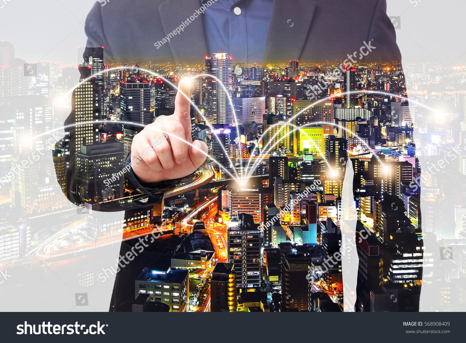 Double exposure of connectivity concept - businessman using smartphone with city overlay #568908409