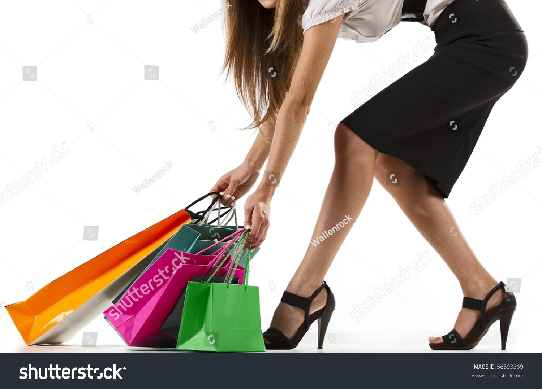 beautiful stylish woman pulling shopping bags stock photo 56893369
