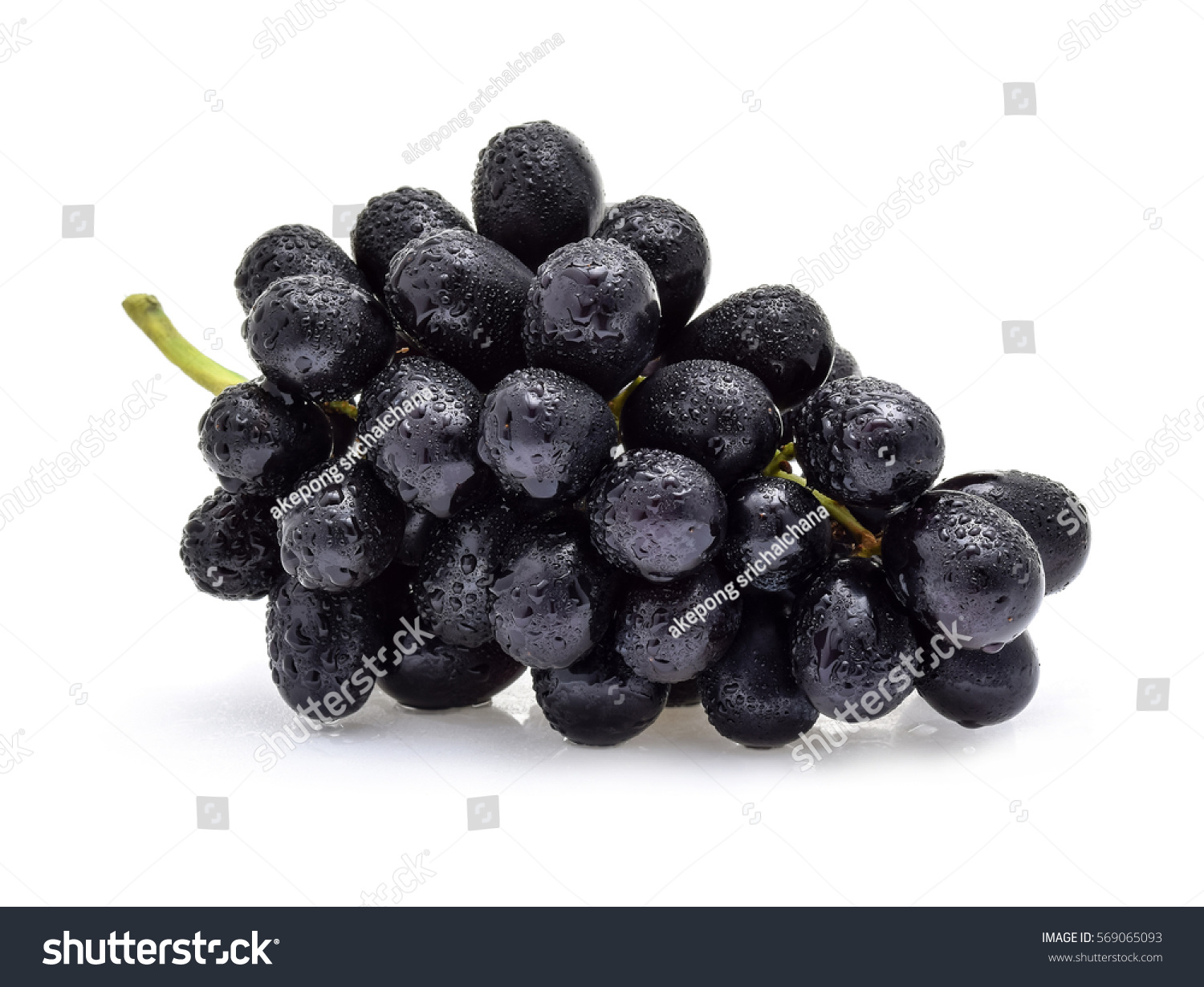 Black grapes with drop of water isolated on white background. #569065093