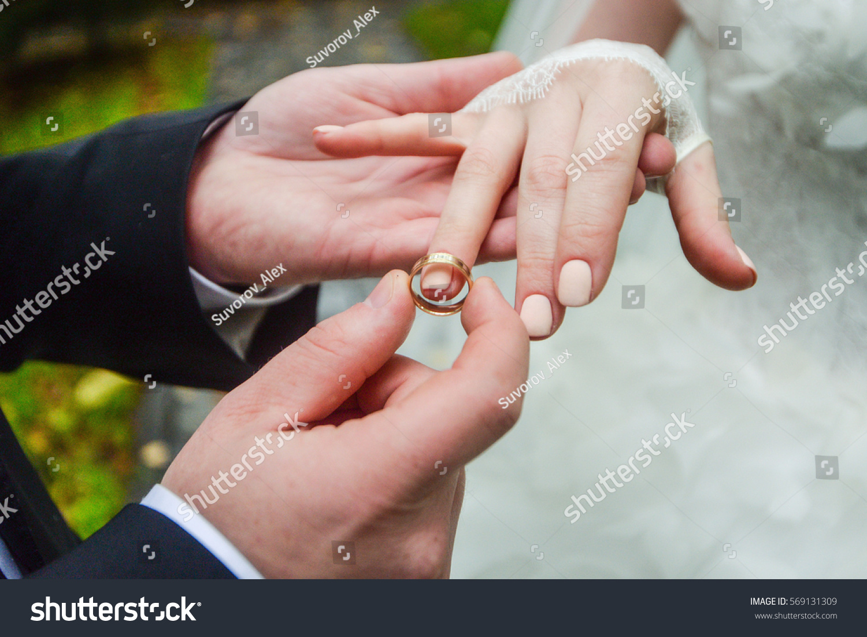 Birde Wears Ring On Finger Groom Stock Photo 569131309 - Shutterstock