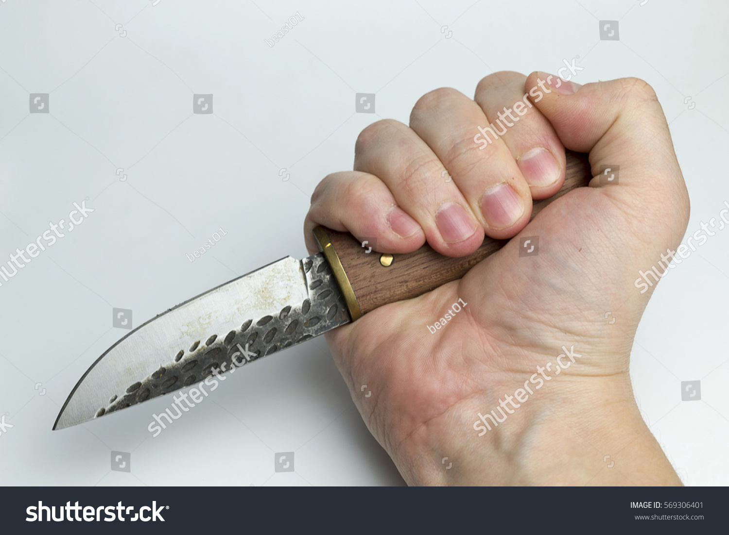 how to hold a cutting knife