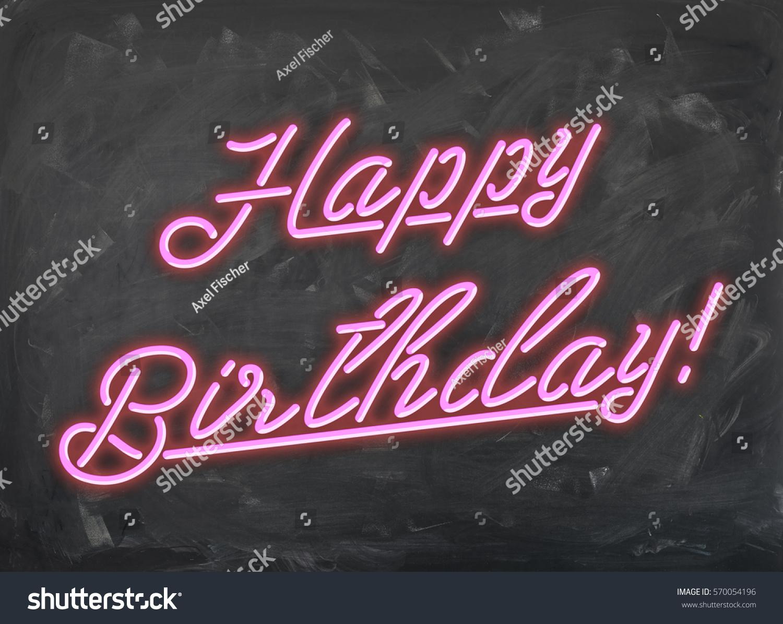 happy birthday pink neon font on handwiped dark chalk board