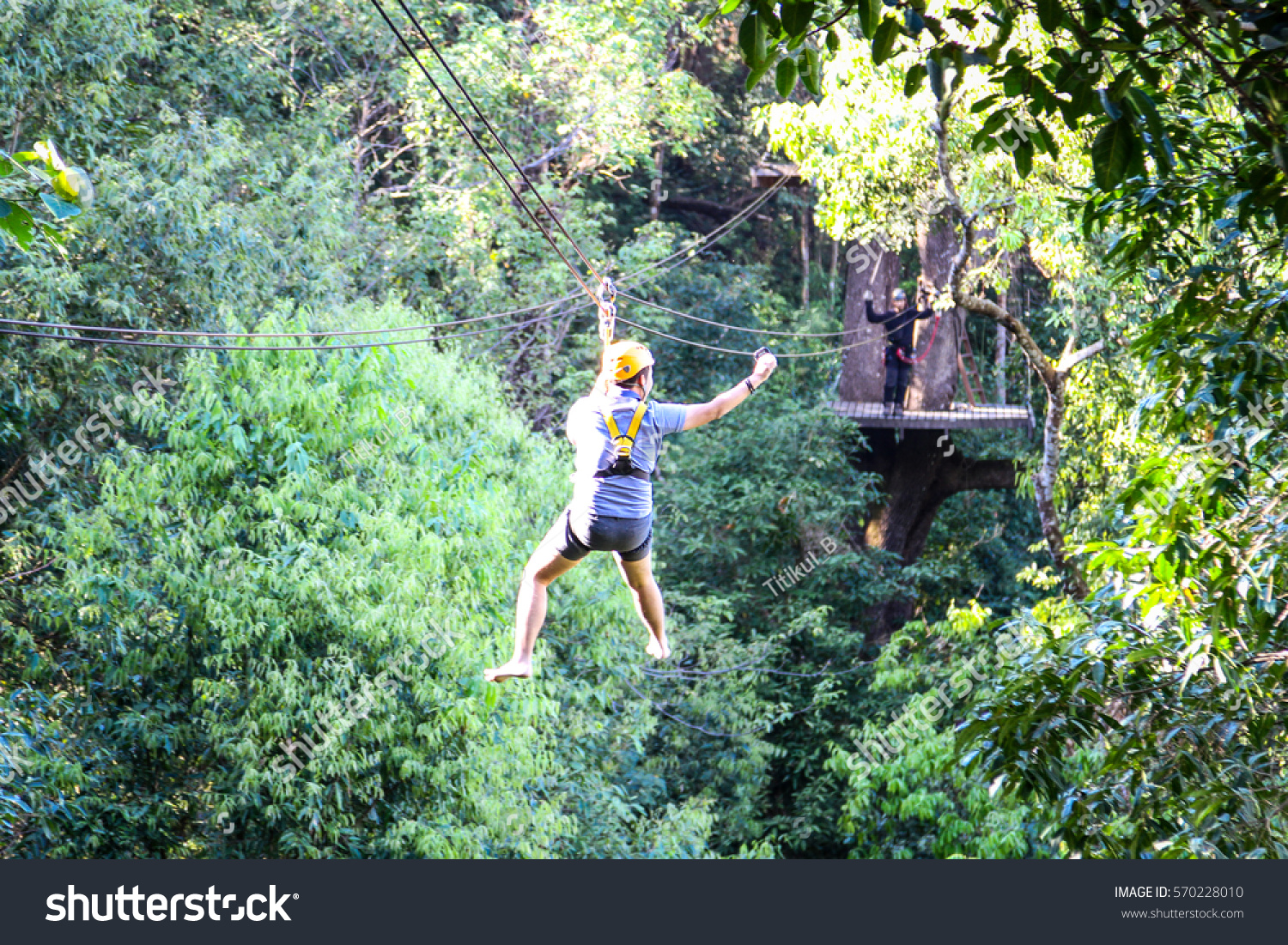 Blurred Traveler Hung On Wire Rope Stock Photo (Edit Now) 570228010 ...