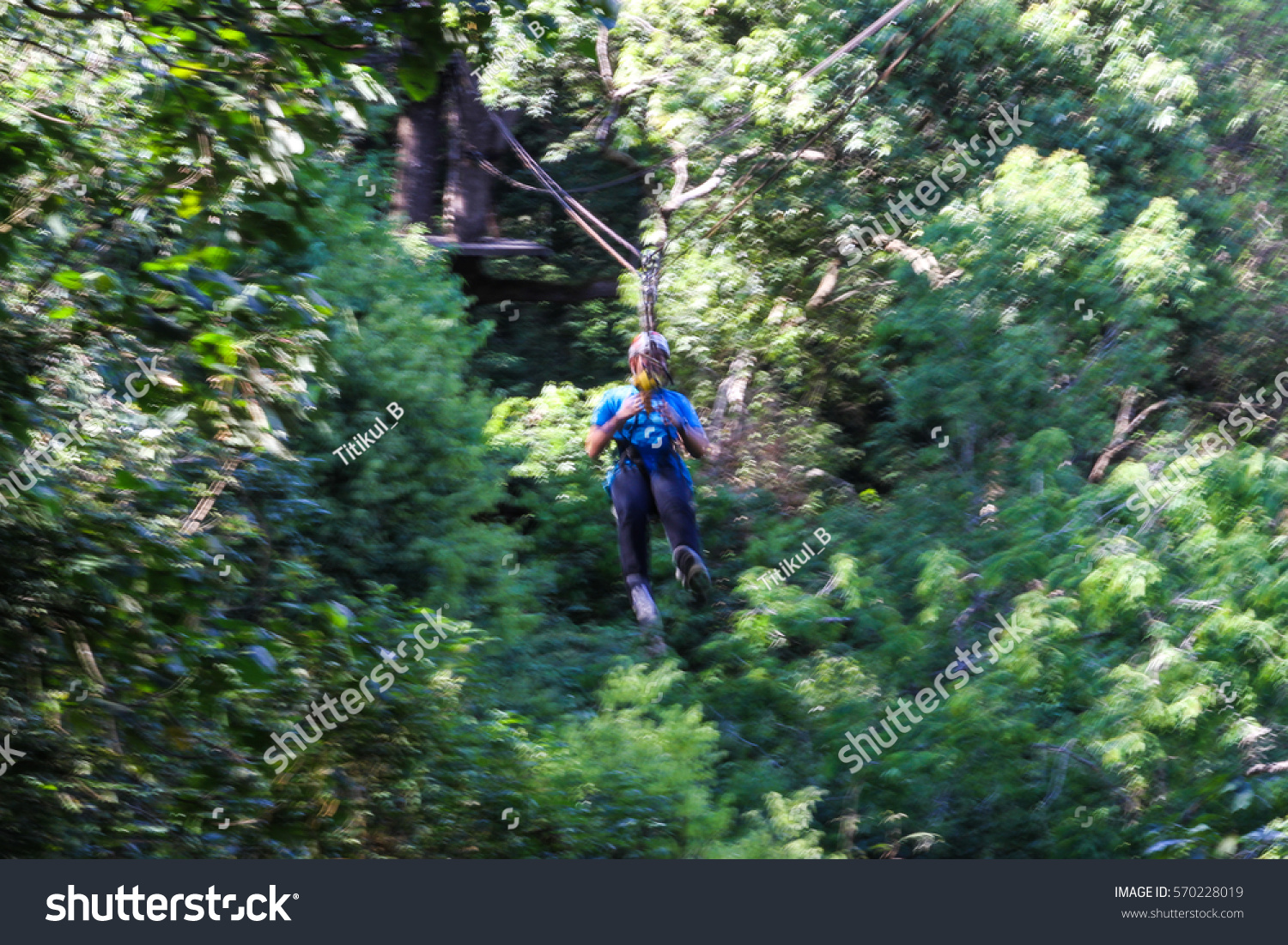 Blurred Traveler Hung On Wire Rope Stock Photo (Edit Now) 570228019 ...
