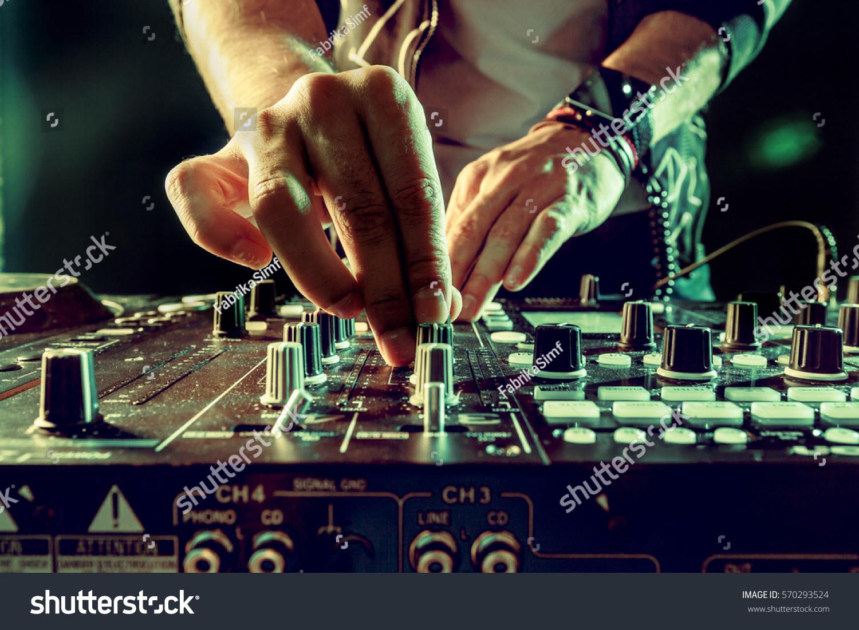 DJ playing music at mixer closeup #570293524