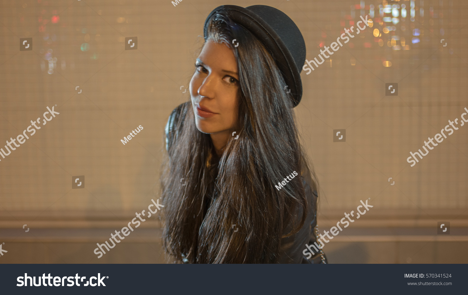 Young woman in black hat looking at camera, retro color shot, colorized image, selective focus. Colorized vintage looking image.