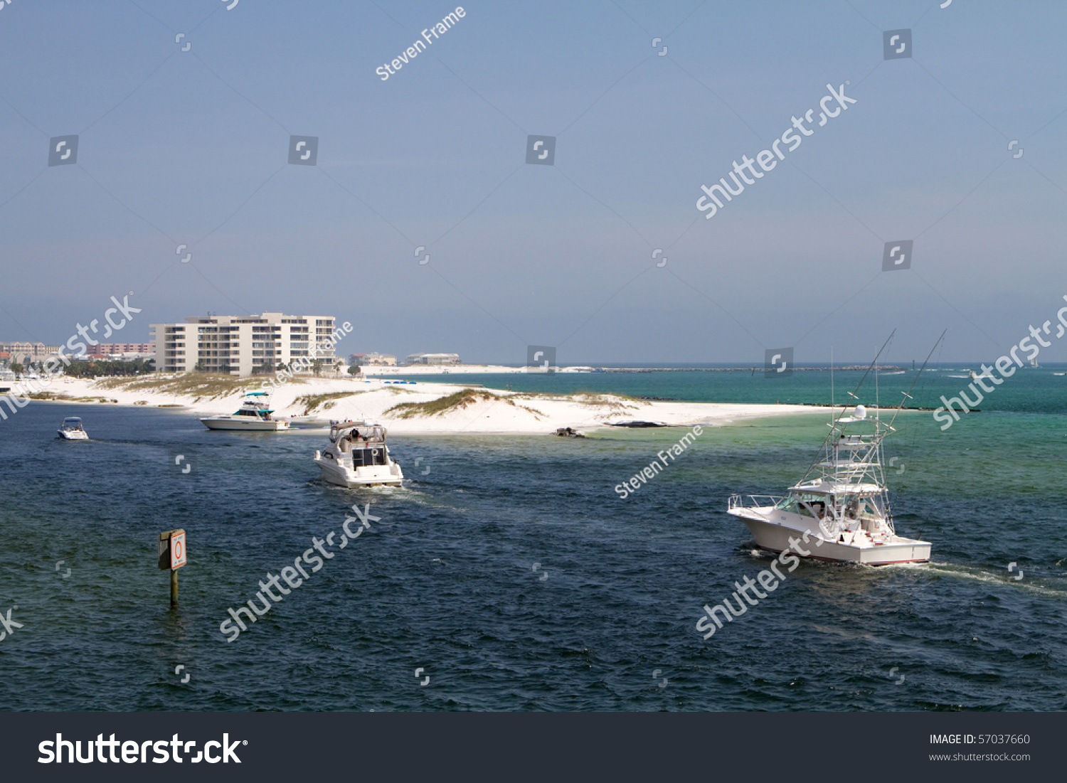 Charter fishing boats enter destin harbor stock photo for Bay fishing destin fl