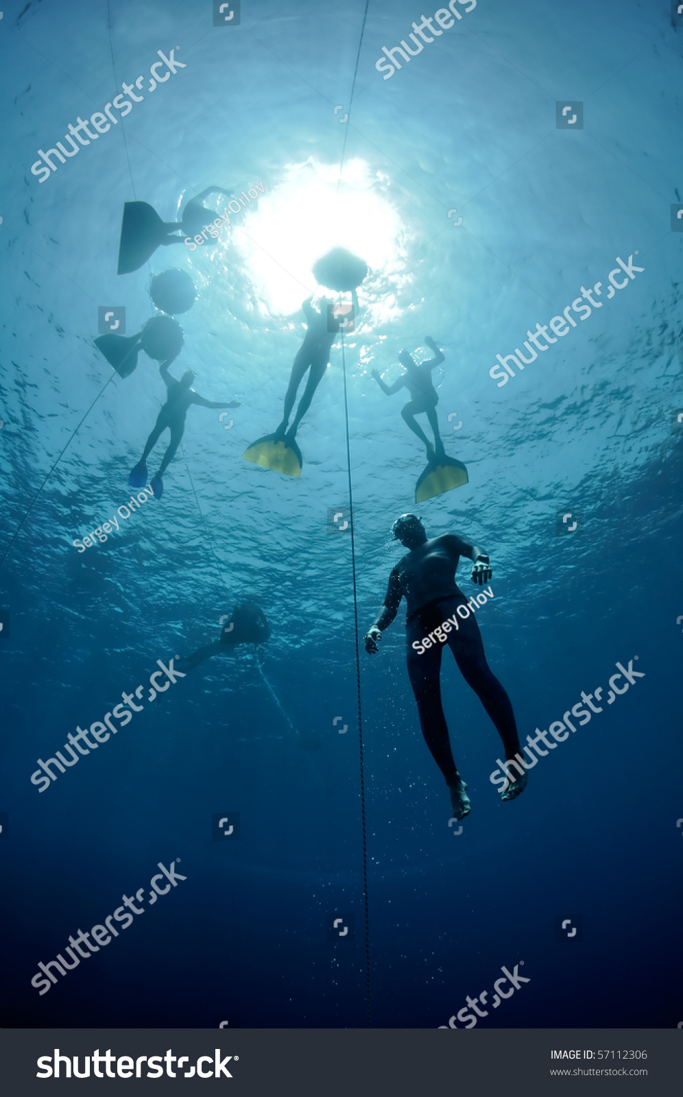 Freediver Makes Preparation Dive Near The Safety Line By