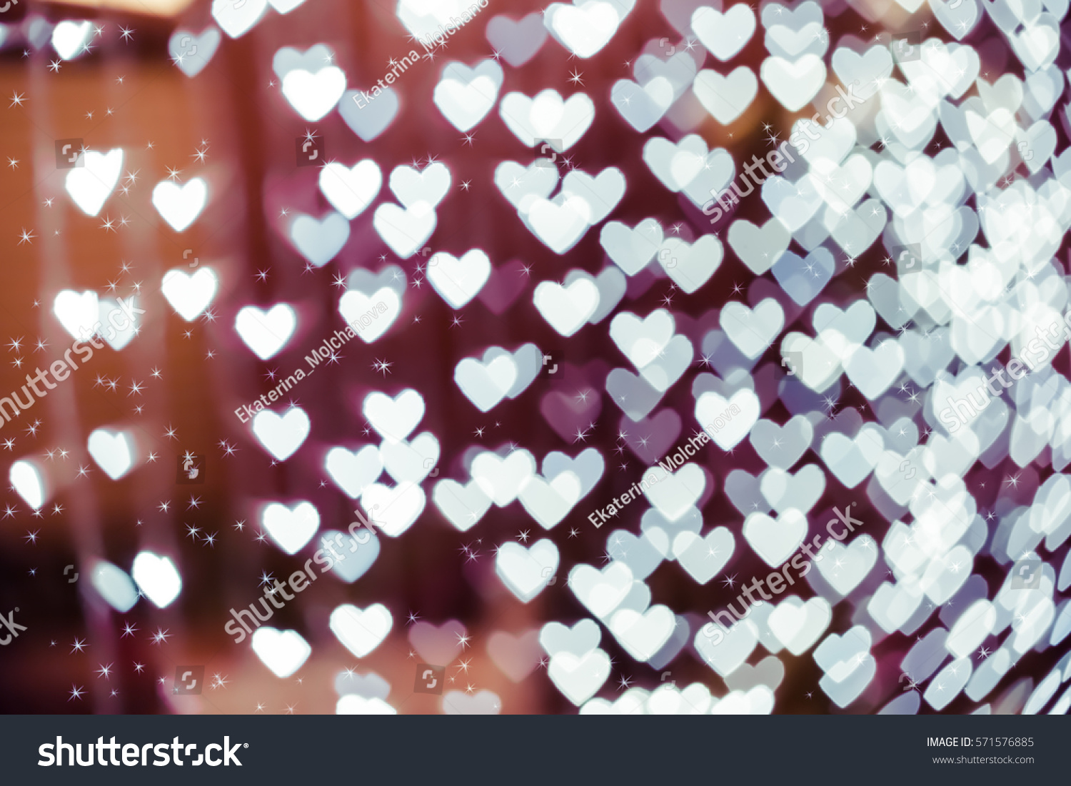Heart shaped holiday blurred bokeh background stock photo