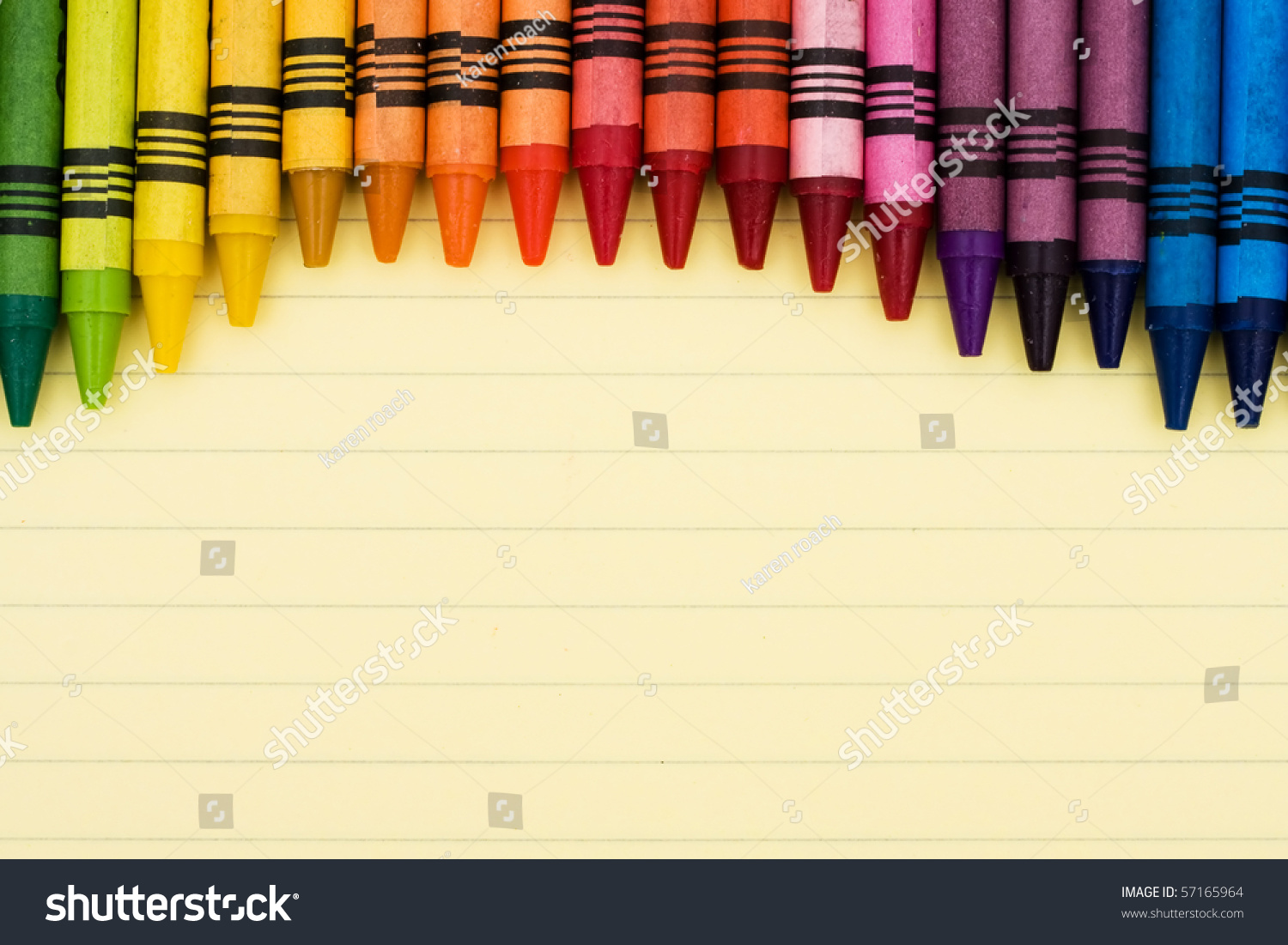 colorful crayons on sheet lined paper stock photo 57165964
