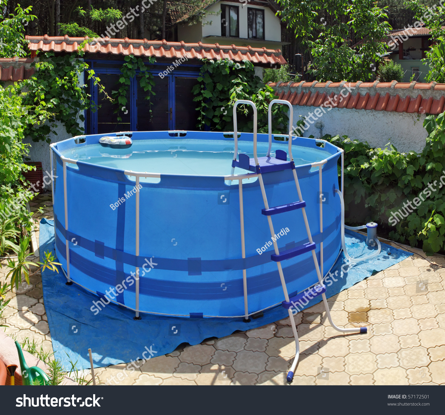 Large above ground metal frame swimming stock photo 57172501 shutterstock for Large above ground swimming pools