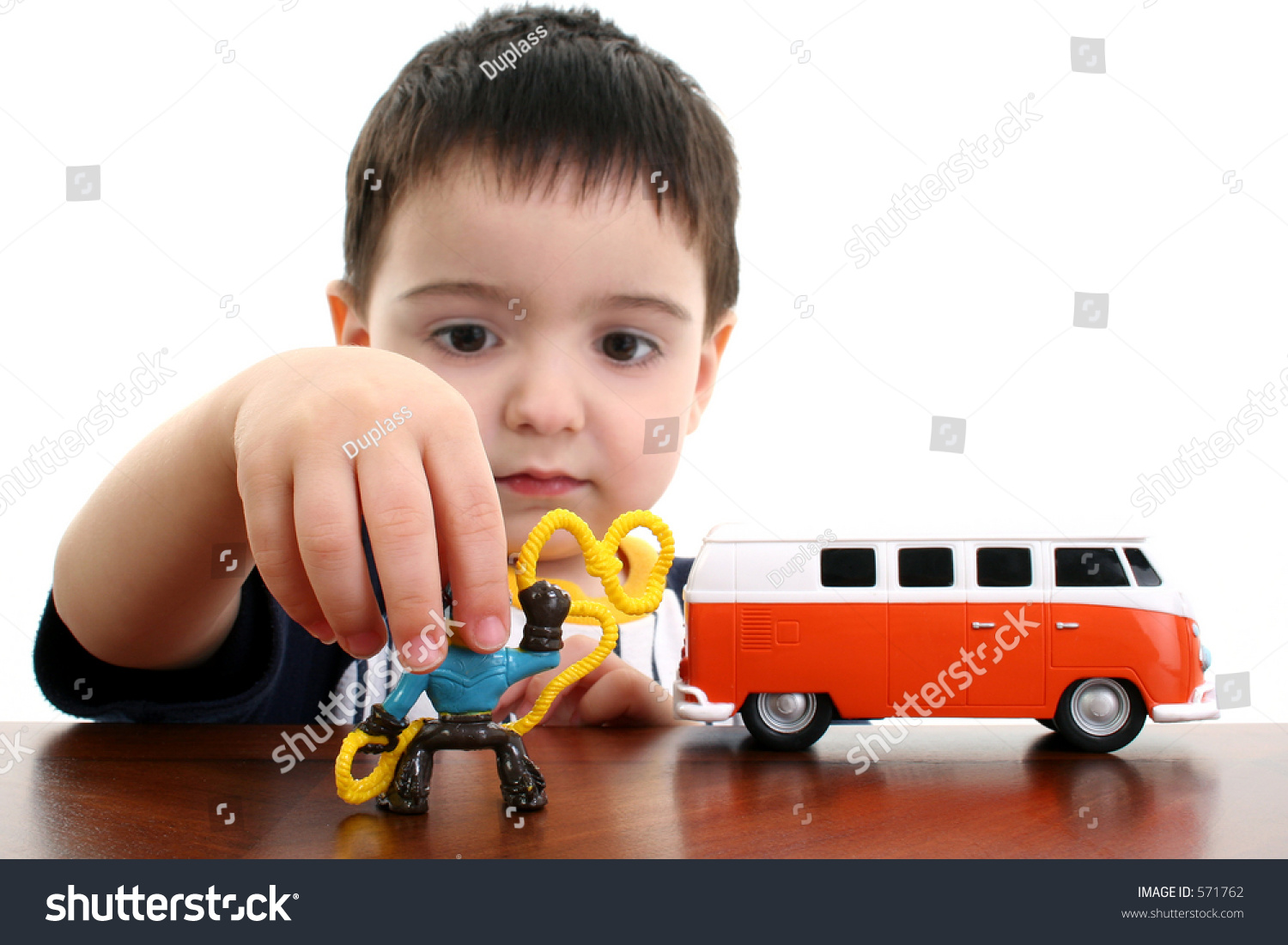 Baby Boy Toy Cars : Toddler boy playing with toy car and cowboy shot in