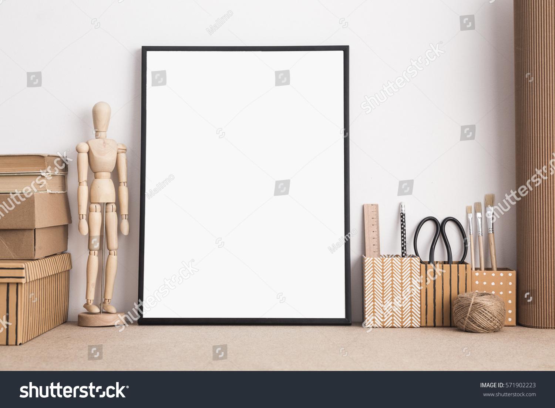 mock black frame on artist desk stock photo 571902223 shutterstock
