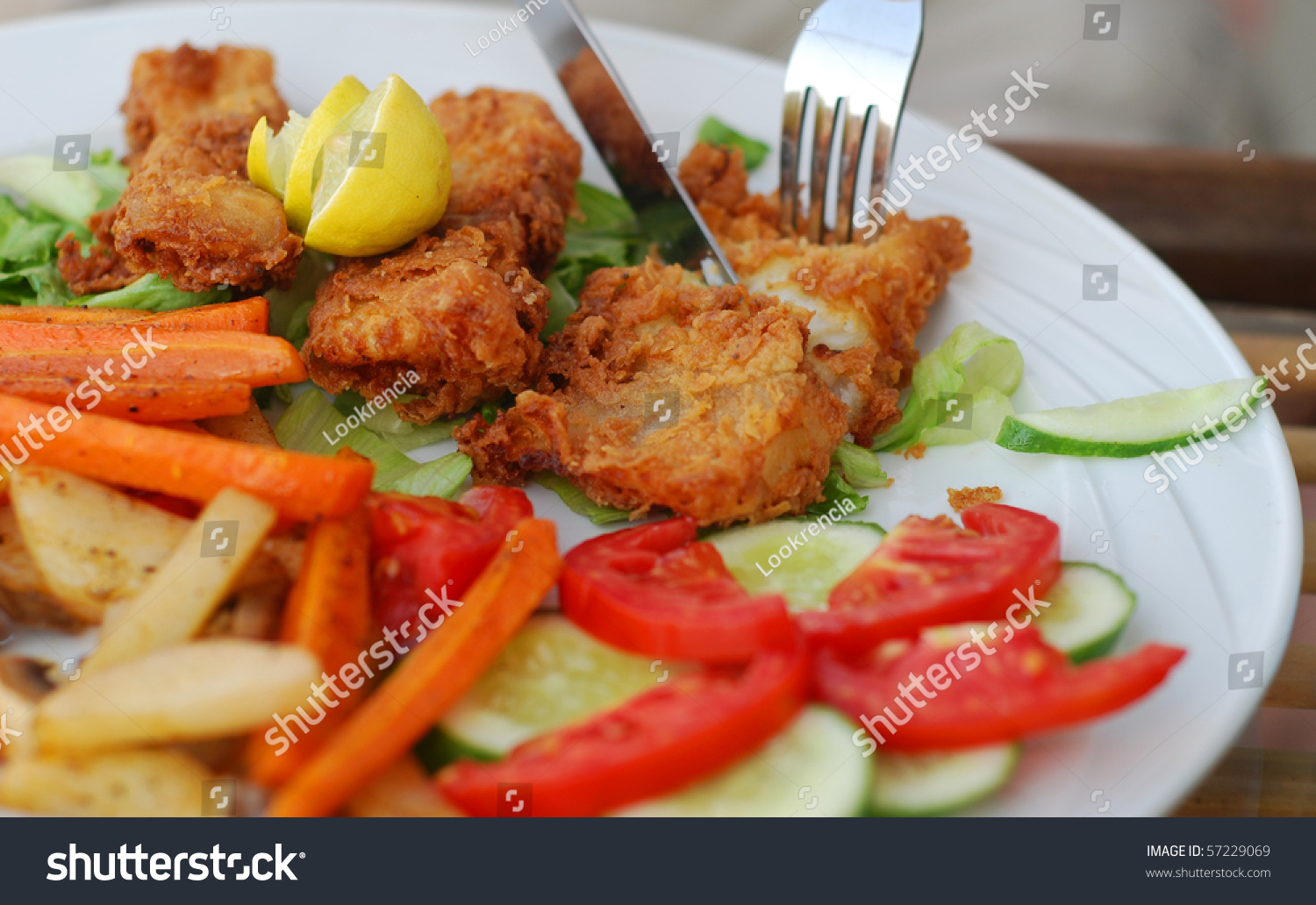 Fried fish with vegetables stock photo 57229069 shutterstock for Fish with vegetables