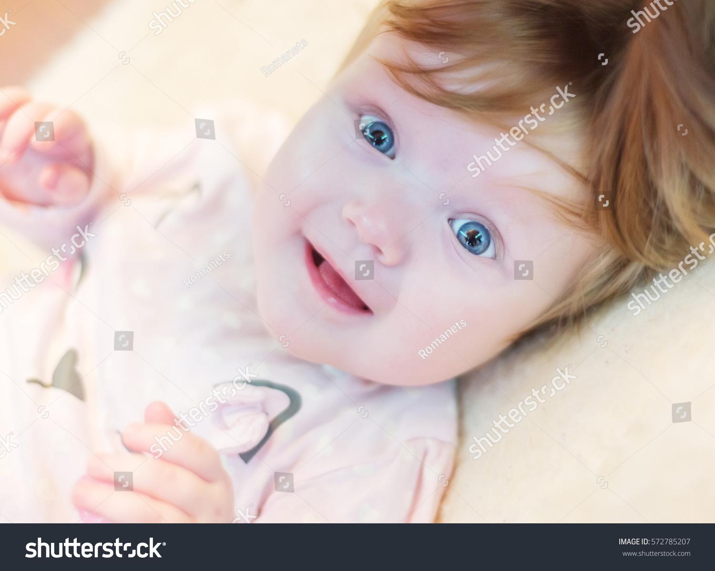 cute baby girl blue eyes stock photo (edit now) 572785207 - shutterstock
