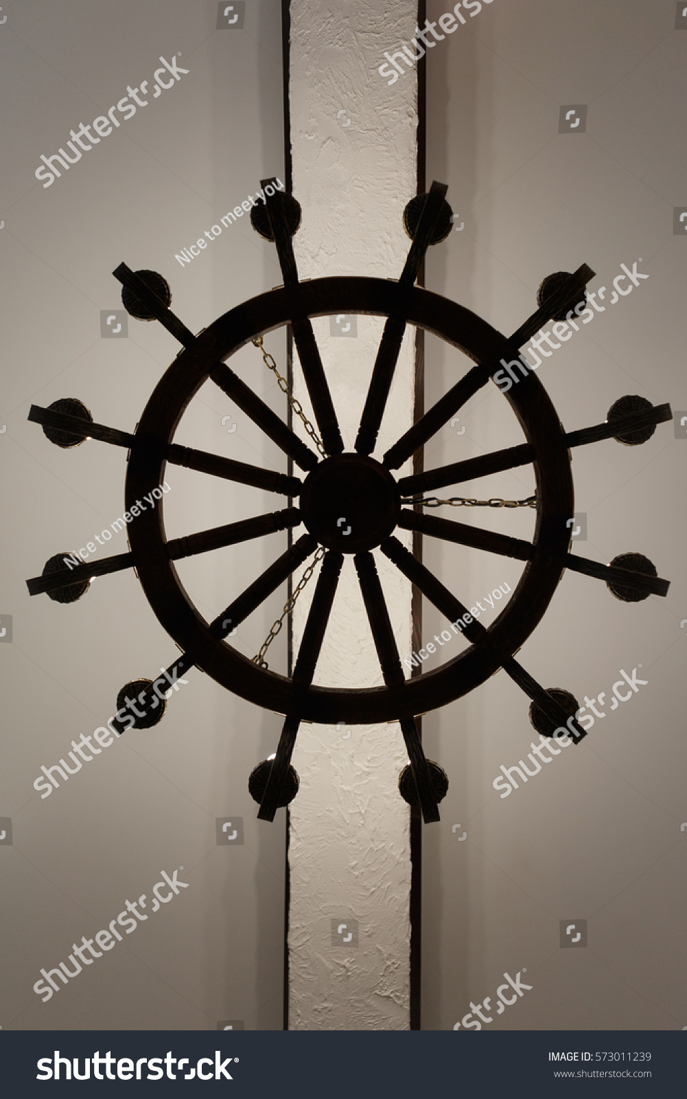 Antique ships wheel chandelier stock photo 573011239 shutterstock antique ships wheel chandelier arubaitofo Image collections