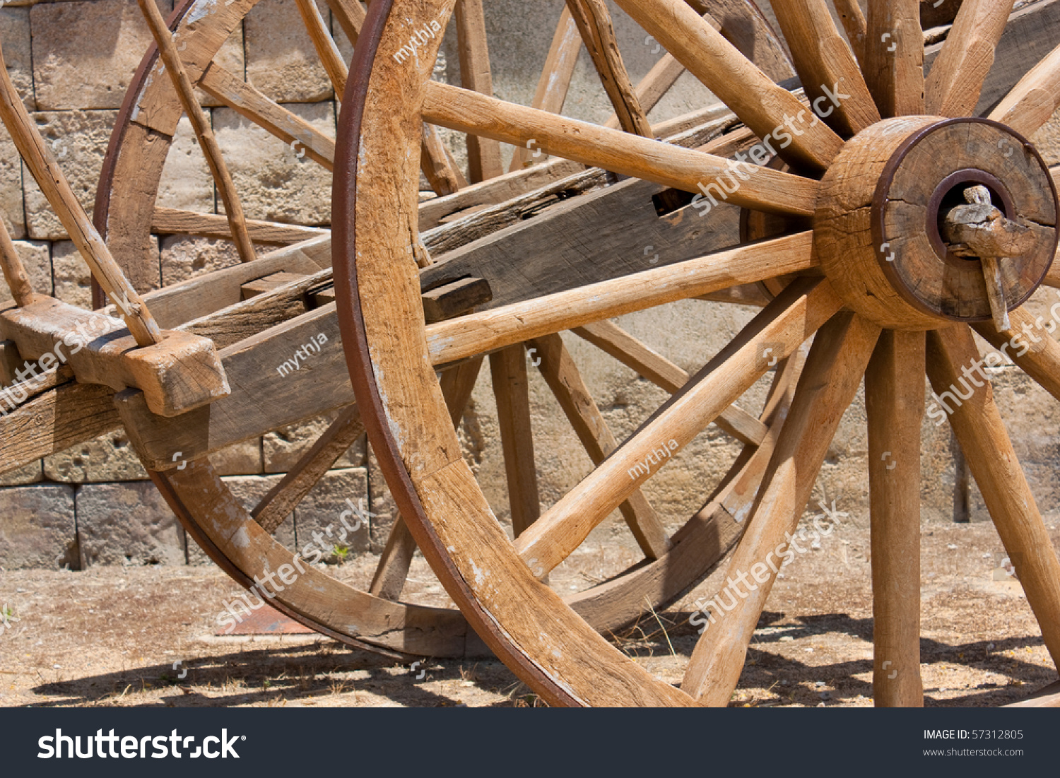 Old Wooden Cart Close Up With Large Wooden Wheels. Stock