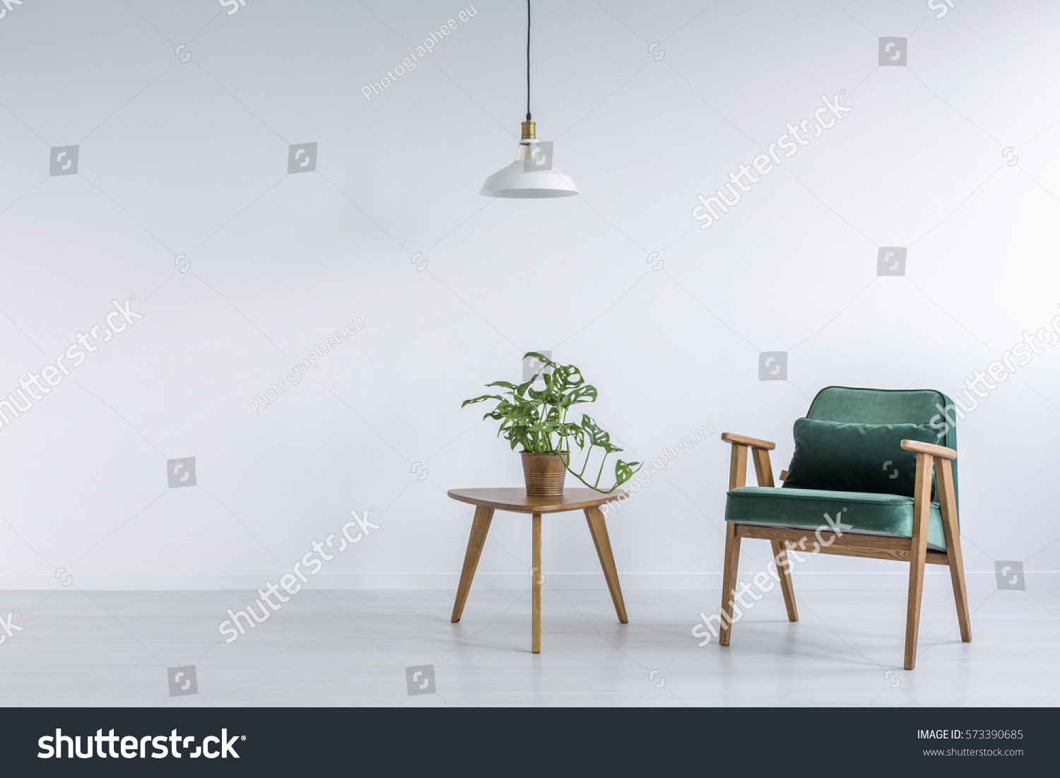 White room green armchair small table stock photo for Small white armchair